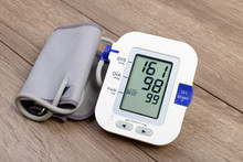 Automatic Blood Pressure Monitor On Wooden Table