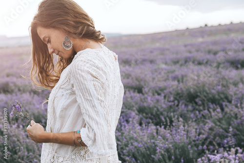 Fototapeta Boho styled model in lavender field obraz