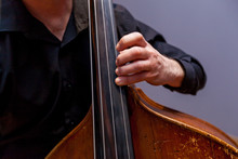 A Man Playing On A Double Bass