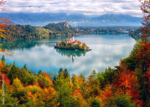 Fototapety, obrazy: Famous alpine Bled lake (Blejsko jezero) in Slovenia, amazing autumn landscape. Aerial view of the lake, island with church, Bled castle and Julian Alps, outdoor travel background