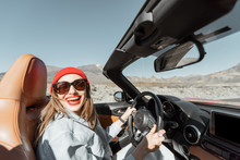 Happy Woman In Red Hat Driving...