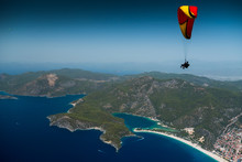 Paragliders Fly In The Clear B...