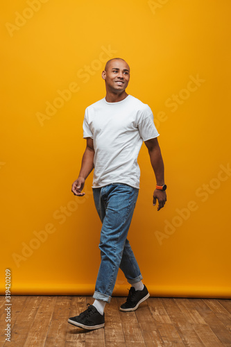Obraz Portrait of an attractive confident casual young man - fototapety do salonu