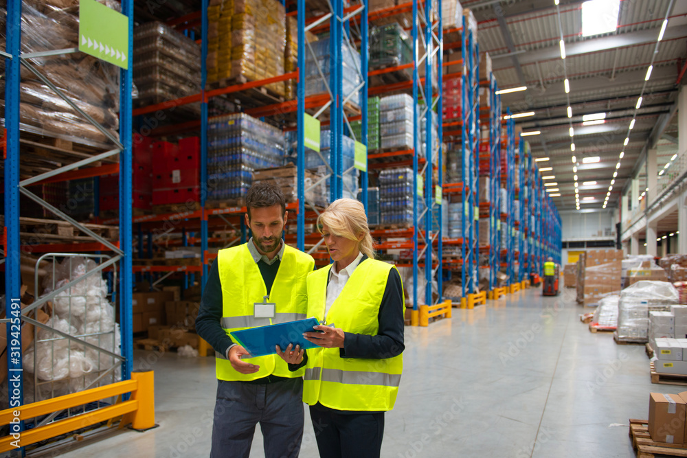 Fototapeta Managers and workers in Warehouse