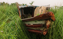 Old Wooden Boat On Grass