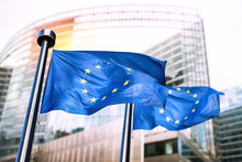 European Union Flags Waving In Front Of European Commission.