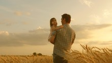 Farmer Carries Little Daughter...