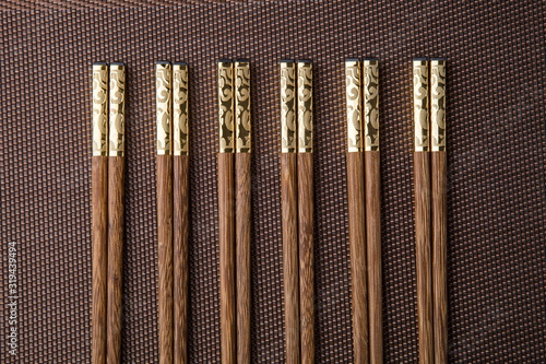 Fototapeta Wooden chopsticks inlaid with metal texture