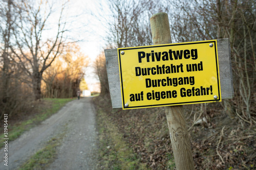 Yellow signpost for a private road in german Canvas Print