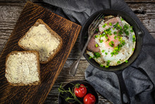 Fried Eggs With Ham On An Old ...
