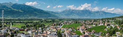 Fototapeta Beautiful panoramic summer view of the capital of Liechtenstein Vaduz and the Swiss Alps in the background.  obraz