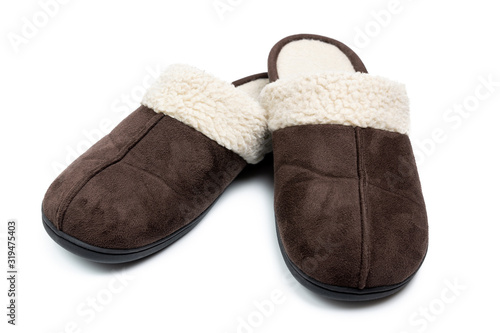 Pair of man brown warm shoes isolated on white background Wallpaper Mural