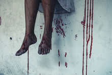 Horror Scence Leg Of Women Sitting And Blood On The Wall At Abandoned House. Halloween Concept