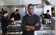 canvas print picture African-American chef in kitchen of restaurant