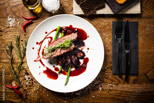 Foto Duck breast served on a plate in restaurant