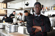 canvas print picture Aafrican american confident chef male in kitchen of restaurant