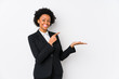 Middle aged african american business  woman against a white background isolated excited holding a copy space on palm.