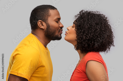 Obraz na plátně love, relationships and valentines day concept - happy african american couple r