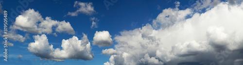Obraz na plátně Wide Angle Landscape With blue sky with clouds and sun.