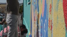 Community Painting Mural On Su...