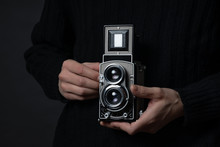 Man Holding An Old Twin Lens Reflex Camera, Also Known As TLR Camera