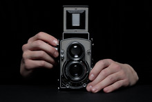 Man Hands Using A Retro Twin Lens Reflex Camera, Also Known As TLR Camera