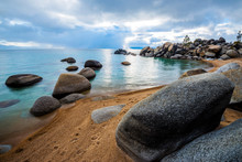 Granite Boulders Line A Beautiful Beach With Clouds Overhead On The East Shore Of Lake Tahoe, Nevada