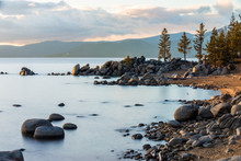 Granite Boulders Line A Beautiful Beach With Clouds Overhead At Sunset On The East Shore Of Lake Tahoe, Nevada