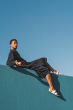 Young Man Wearing Black Kaftan...