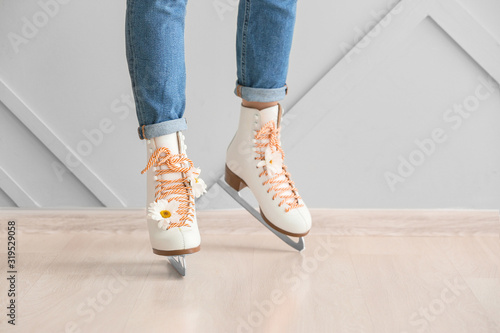 Fototapeta Young woman in ice skate shoes indoors obraz