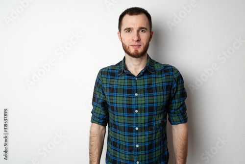 Portrait of a young handsome man on a white background Tablou Canvas
