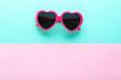 Leinwanddruck Bild - Modern heart shaped sunglasses on colorful background