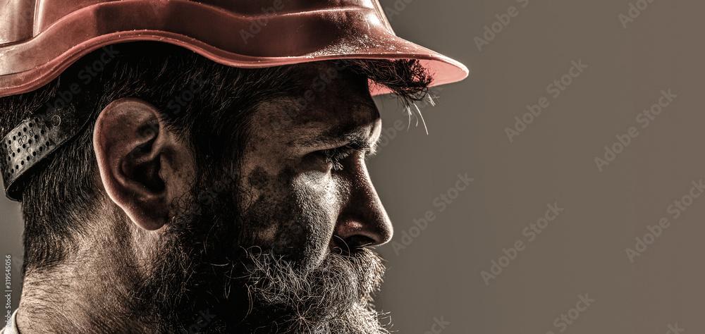 Fototapeta Portrait of handsome engineer. Builder in hard hat, foreman or repairman in the helmet. Worker in hardhat. Portrait mechanical worker. Bearded man in suit with construction helmet. Copy space