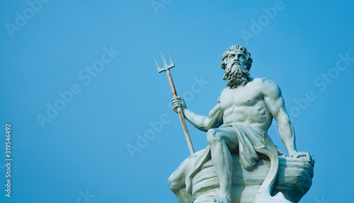 Stampa su Tela Ancient stone statue of mighty god of the sea and oceans Neptune (Poseidon) with trident