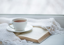 Warm Knitted Scarf, A Cup Of Hot Tea And A Book