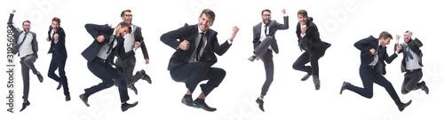 Fototapeta in full growth. two cheerful dancing business people obraz