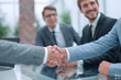 business handshake on the background of applauding business team