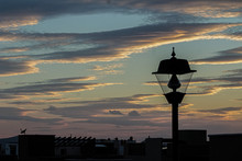 Sunset And Street Lamp