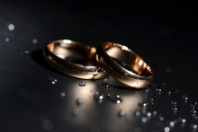 Wedding Rings Black Background...