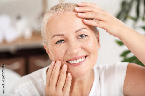 Beautiful mature woman with healthy skin at home Wallpaper Mural