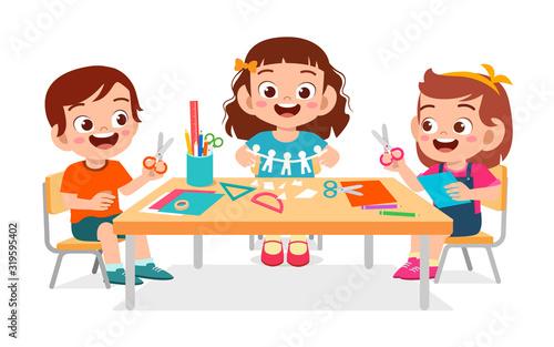 Slika na platnu happy cute little kids boy and girl make paper craft
