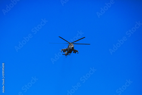 Valokuvatapetti Russian military helicopter during flight in the air, a squadron formation of he