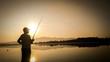 Silhouette Man Fishing By Lake During Sunset
