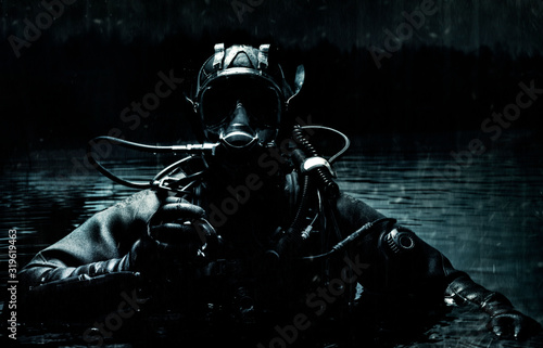 Military diver emerges from under the water Wallpaper Mural