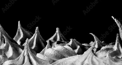 Fotografie, Obraz Close-Up Of Whipped Cream Against Black Background