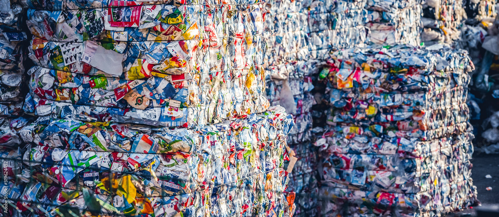 Fototapeta Recycling and storage of waste for further disposal, trash sorting. Picture of recycled plastic waste pressed to bales. Plastic bottles,compressed