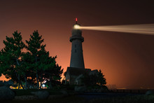 Lighthouse Searchlight. Night Marine Embankment Of Weihai