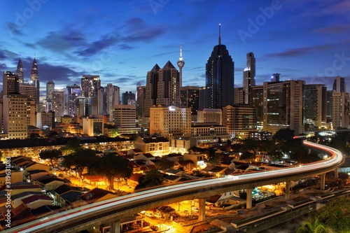 Fototapeta AERIAL VIEW OF ILLUMINATED BUILDINGS IN CITY AGAINST SKY obraz