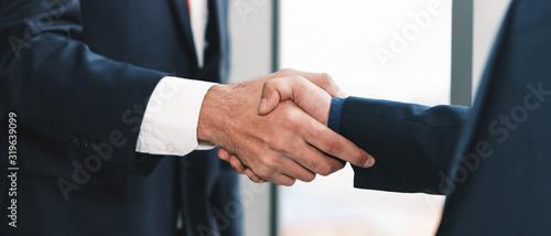 business background of businessman having handshaking after finish business deal Canvas Print
