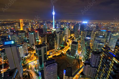 Fototapeta HIGH ANGLE VIEW OF CITY LIT UP AT NIGHT obraz